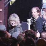 Lucinda Williams greeting fans by the stage.