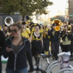 A marching band began to play behind the convention center
