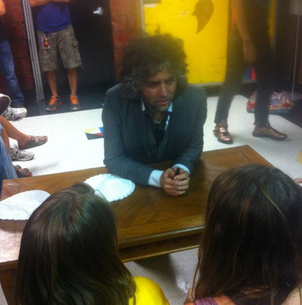 Wayne Coyne of The Flaming Lips chatting it up with fans when they headlined in 2012